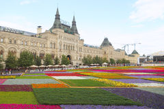 Flower beds against GUM mall building in Moscow. Royalty Free Stock Photography