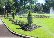 Flower beds being watered Royalty Free Stock Images