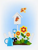 Flower beds and bird house Royalty Free Stock Photos
