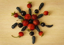 Flower of berries. Summer berries: strawberries, black currants, honeysuckle royalty free stock photography