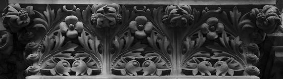 Flower blacony decoration with special light. Shot and black and white, detail on the sculpture on the facade of this historic building representing some plants Stock Photography