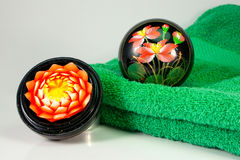 Flower blossom and green towel. Aromatic blossom candle and green towel Stock Images