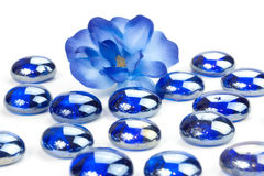 Flower with blue spa stones Royalty Free Stock Photo