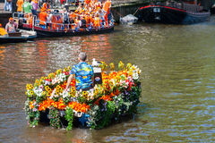 Flower boat in canal - Koninginnedag 2012 Royalty Free Stock Photography