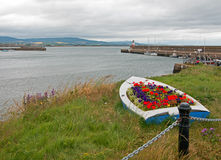 Flower Boat view of Wicklow Ireland Harbor and Lighthouse Royalty Free Stock Image