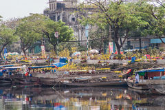 Flower boats at flowers market on Binh Dong wharf at Saigon ( Ho Chi Minh City ) , Vietnam on Lunar New Year ( TET holiday ) Stock Photo