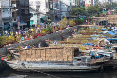 Flower boats at flowers market on Binh Dong wharf at Saigon ( Ho Chi Minh City ) , Vietnam on Lunar New Year ( TET holiday ) Royalty Free Stock Photo