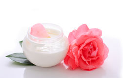 Flower body cream. With pink rose over white Royalty Free Stock Image