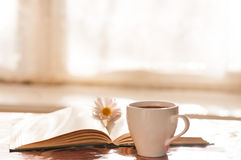Flower on the book, the Cup of black coffee Stock Photo