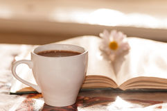 Flower on the book, the Cup of black coffee Royalty Free Stock Photo