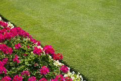 Flower border and lawn Royalty Free Stock Photography