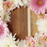 Flower border. On a wooden background Royalty Free Stock Images