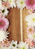 Flower border. On a wooden background Royalty Free Stock Photo