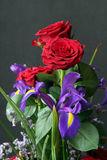 Flower bouquet. Of roses and iris Stock Image