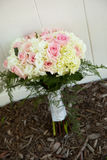 Flower bouquet. Bouquet of roses and ferns on the ground Royalty Free Stock Image