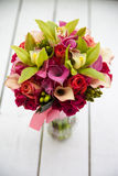 Flower bouquet. Bright flower bouquet on wooden table Stock Photo