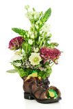 Flower bouquet arrangement centerpiece in old shoe with frogs Stock Images