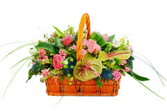 Flower bouquet arrangement centerpiece in a wicker gift basket Royalty Free Stock Photos