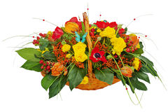 Flower bouquet arrangement centerpiece in a wicker gift basket Stock Images