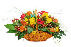 Flower bouquet arrangement centerpiece in a wicker gift basket Stock Photo