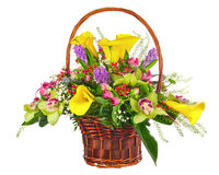 Flower bouquet arrangement in wicker basket isolated on white ba Royalty Free Stock Photo
