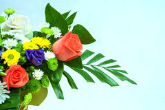 Flower bouquet in basket royalty free stock photography