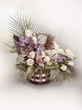 Flower bouquet in basket. Bouquet with colorful flowers in basket with blurred background Stock Photo