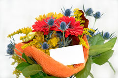 Flower bouquet with blank gift card Stock Photo