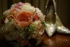 Flower bouquet. Colourful flower bouquet and shinning high heels Stock Image