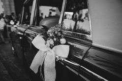 Wedding ornament decoration in a classic car. Black and white. Royalty Free Stock Photography