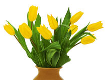 Flower bouquet fromyellow tulips in brown vase Royalty Free Stock Images