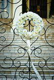 Flower bouquet in front gate at wedding reception Royalty Free Stock Image