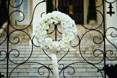 Flower bouquet in front gate at wedding reception Stock Images