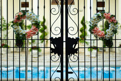 Flower bouquet in front gate at wedding reception Royalty Free Stock Photos