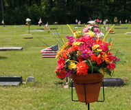 Flower bouquet at grave site Royalty Free Stock Photography