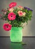 Flower bouquet in green vase Stock Photos