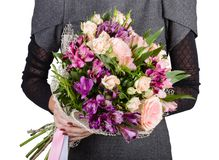 Flower bouquet in the hands of the girl stock photography