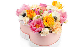 Flower bouquet in a heart shaped box isolated on white Royalty Free Stock Photos