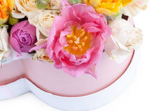 Flower bouquet in a heart shaped box isolated on white Stock Images
