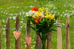 Flower bouquet with hearts Royalty Free Stock Images