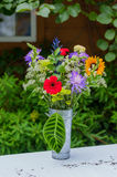 Flower bouquet in a metal vase Stock Image