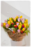 Flower bouquet of multicolor tulips in white vase. Spring vertical background with copy space. Women`s Day, Mother`s Day Royalty Free Stock Image