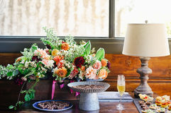 Flower Bouquet Near Wine and Table Lamp Stock Photography