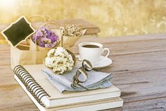 Flower bouquet with notebook the latte coffee cup and glasses on Royalty Free Stock Photos