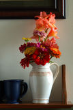Flower Bouquet in Old Antique Pitcher on Shelf Royalty Free Stock Photo