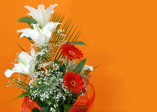 Flower bouquet over orange Royalty Free Stock Photos