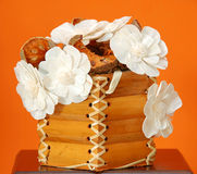 Flower bouquet over orange Stock Image