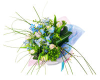Flower bouquet from pink roses, iris and other flowers. Stock Photos