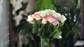 Flower bouquet in the rays of light, rotation, the floral composition consists white and pink Roses . Rose dzhemilja stock video