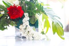 Flower bouquet red peony flower and white Butterfly bush.
